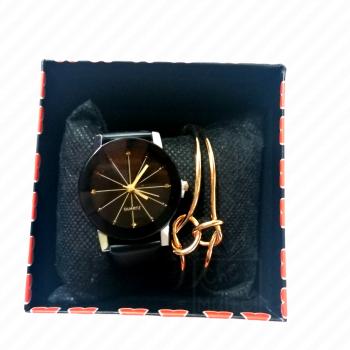 Caja con un Reloj y una...
